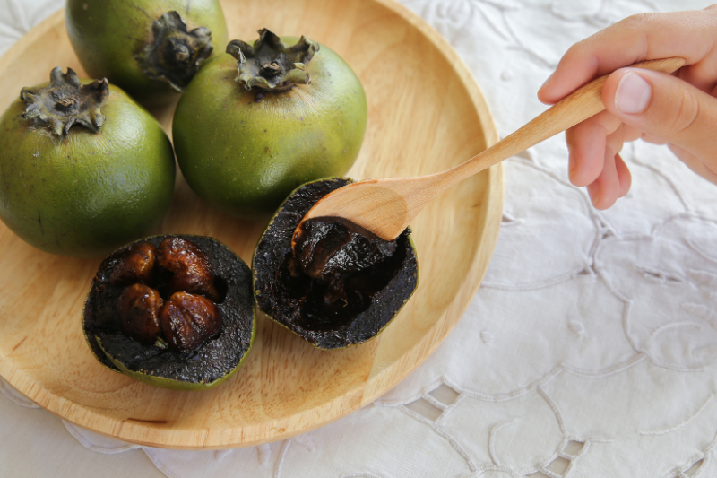 Black Sapote or Chocolate Pudding Fruit on a platter