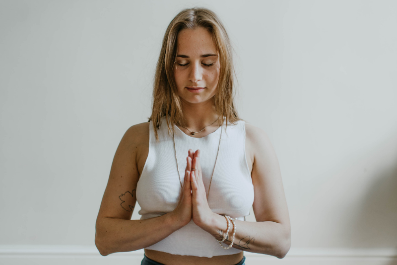 woman in meditating pose, hands together